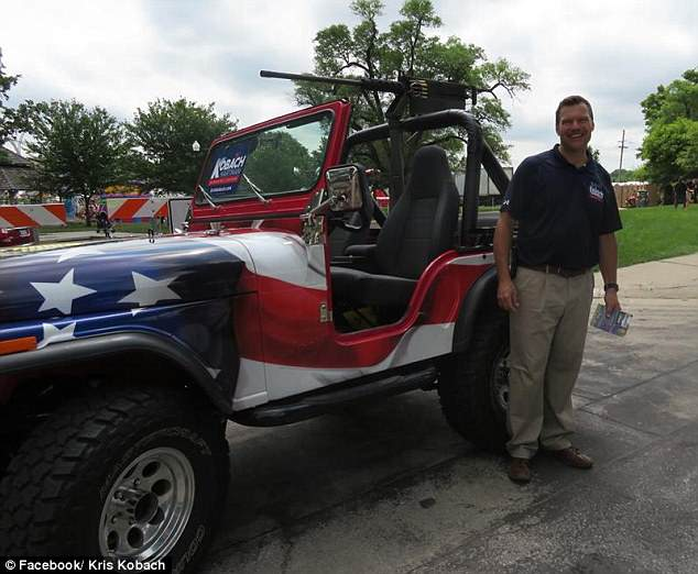 Kansas secretary of state sparks outrage after riding in a parade with a large replica gun mounted on his American flag colored jeep