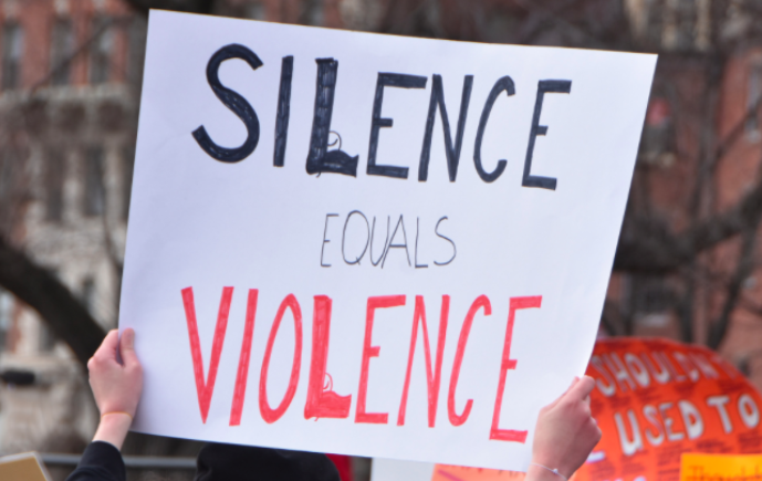 Faculty and students wear orange to protest against gun violence