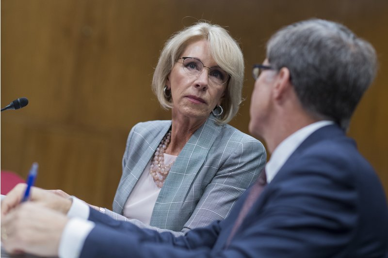Trump's Education Secretary Says School Safety Commission Won't Look at Role of Guns in School Shootings