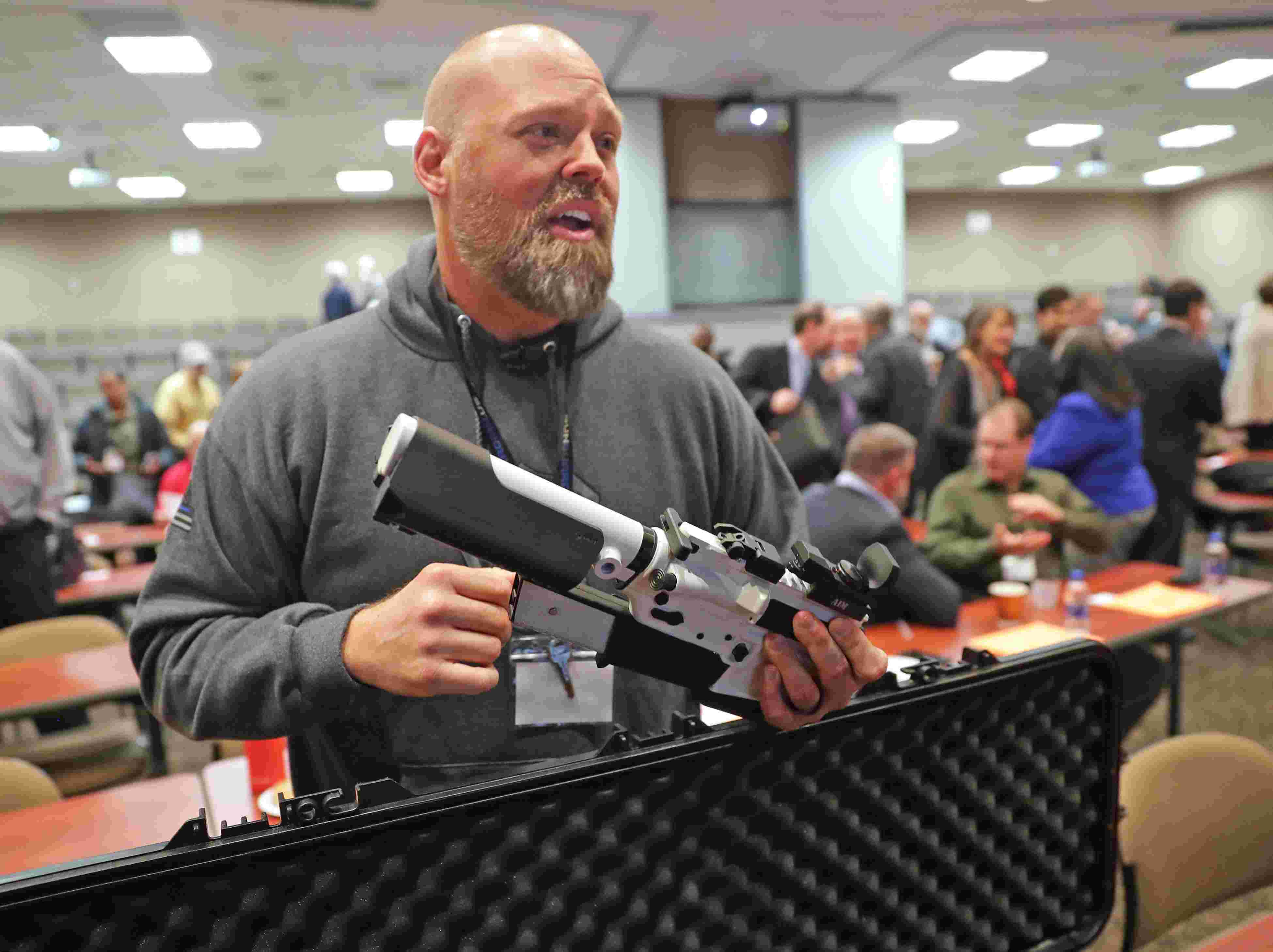A firearm that sends a text if it's moved: Innovators pitch law enforcement on the latest smart guns