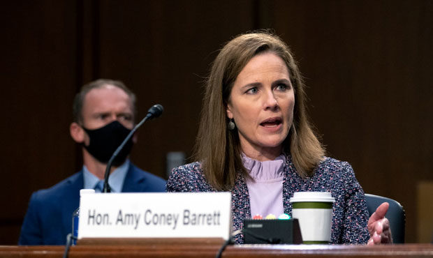 Looking at previous Amy Coney Barrett cases involving abortion, gun rights
